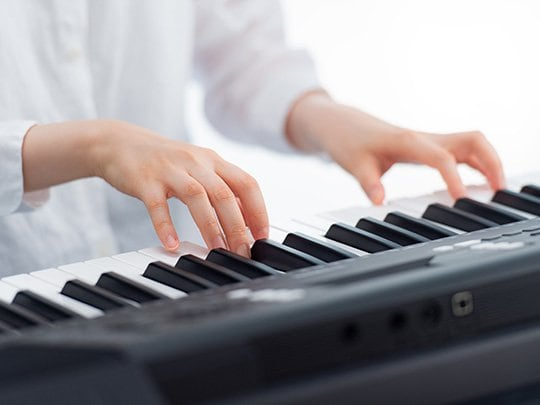 Touch-sensitive keys for expressive dynamic control